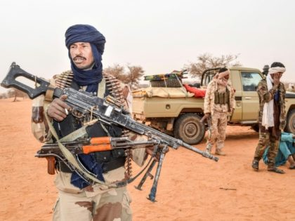 Movement for the Salvation of Azawad militants patrol along the Mali-Niger border on February 3, 2018