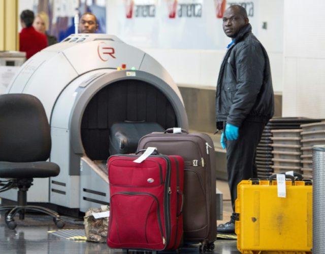 Workers at Washington's Ronald Reagan National Airport process checked baggage thru a TSA X-Ray machine