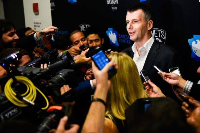 Brooklyn Nets owner Mikhail Prokhorov, pictured in 2014, will continue to be the controlling owner of the team despite selling a 49% stake to Joseph Tsai