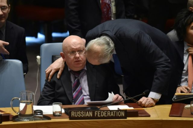Russian Ambassador to the United Nations Vassily Nebenzia(L) talks with Permanent Representative of the Syrian Arab Republic to the United Nations, Bashar Jaafari (R) during a UN Security Council meeting on April 10, 2018