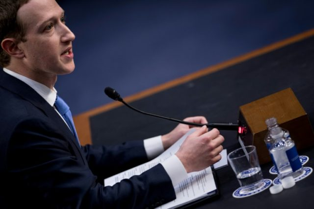 Facebook CEO Mark Zuckerberg speaks during a US Senate hearing on data misuse by the social network