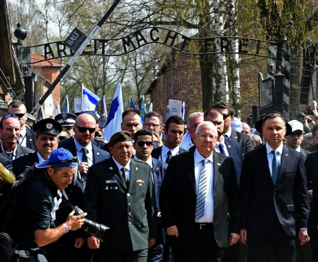 Poland's President Andrzej Duda, right, and his Israeli counterpart Reuven Rivlin, second from the right, lead the March of the Living at the former Auschwitz-Birkenau Nazi German death camp
