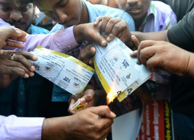 (FILES) In this file photo taken on April 10, 2018 Indian members of the Tamil ethnic group burn match tickets outside the MA Chidhambram cricket stadium during a protest against the Indian Premier league (IPL) amid ongoing demonstrations over water rights in Chennai.India's cricket board is considering shifting Indian Premier …