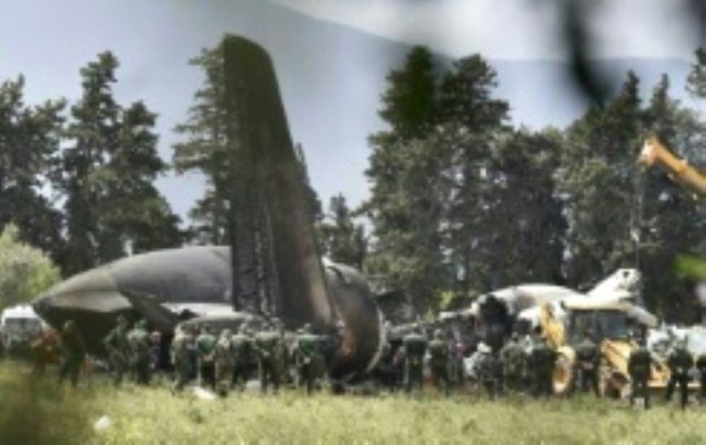 Rescuers gather round the wreckage of an Algerian military plane which crashed shortly after taking off from a base near Algiers on April 11, 2018, killing 257 people