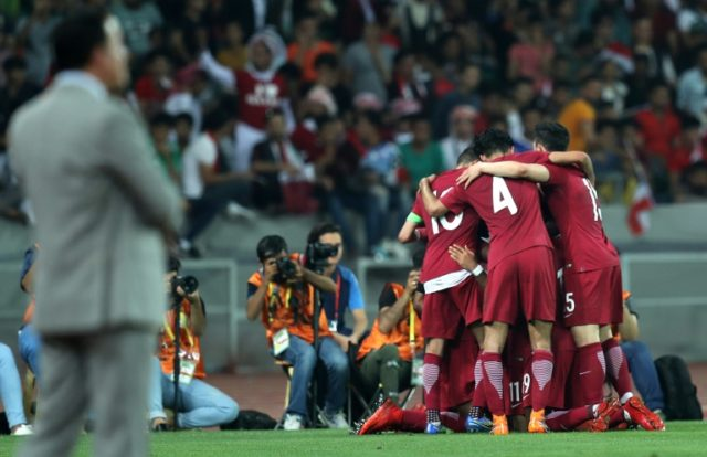 Qatar players celebrate after scoring during a friendly against Iraq recently
