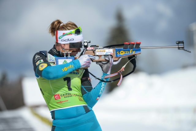 French biathlete Anais Bescond eyes the target in a sport which combines cross country skiing and sharp-shooting