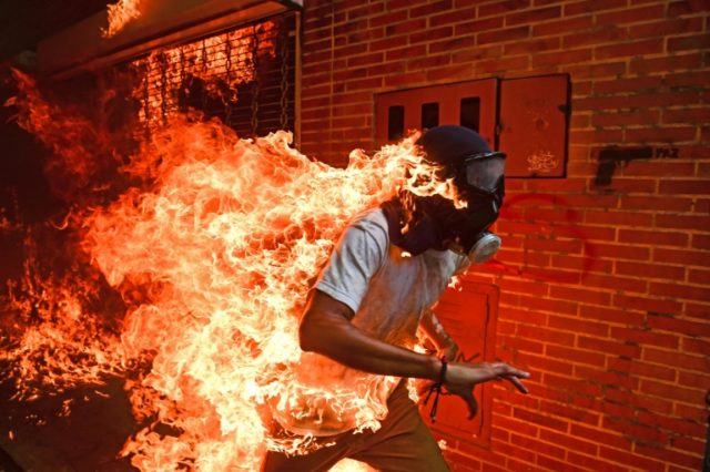 Judges said Ronaldo Schemidt's image of a demonstrator on fire in Venzuela provoked 'instantaneous emotion'