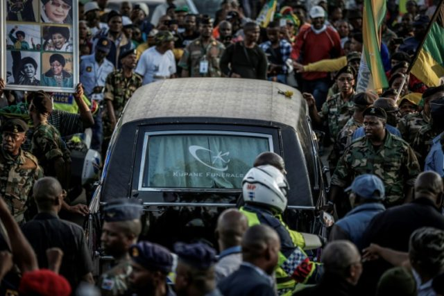 Mourners line the streets of Soweto as a hearse carrying the body of Winnie Mandela makes its way through the township