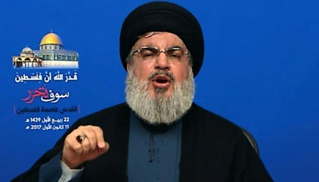 Hezbollah leader Hassan Nasrallah delivers an address on the movement's al-Manar TV on December 11, 2017