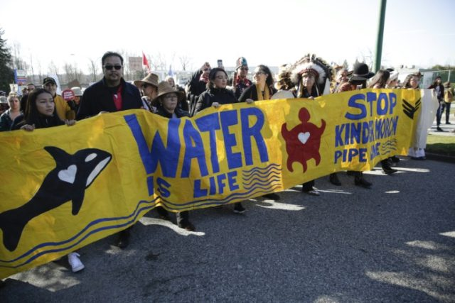 Demonstrators march against the expansion of Texas-based Kinder Morgan's Trans Mountain pipeline project in Burnaby, British Columbia, Canada in March