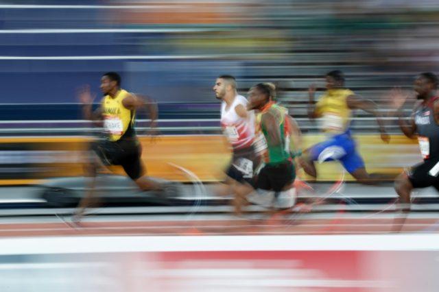 Jamaica's Yohan Blake (L) said he hid his phone when Usain Bolt tried to contact him.