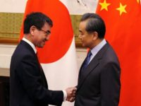 Japanese Foreign Minister Taro Kono (L) met Wang Yi when he visited Beijing in January