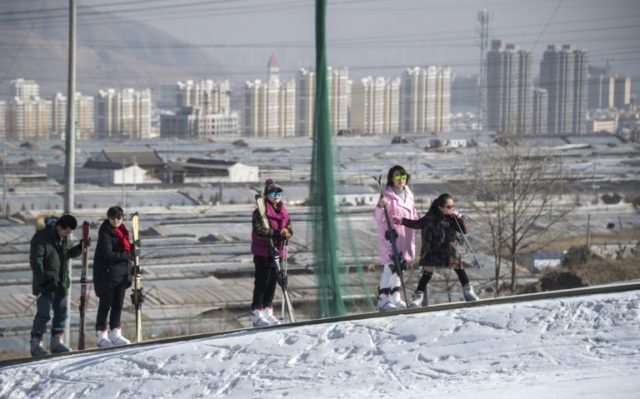 People use a ski lift on the outskirts of Xining, China, which wants to put 10 percent of its population on skis ahead of the 2022 Beijing Winter Olympics