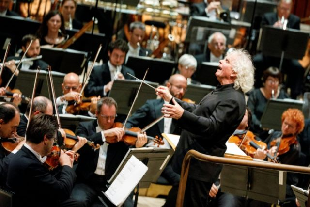 The London Symphony Orchestra's Music Director, Simon Rattle, leads a performace at The Barbican