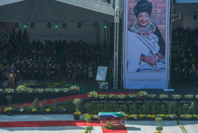 The casket of South African anti-apartheid icon Winnie Mandela is displayed at a pre-burial service at a stadium in Soweto on Saturday
