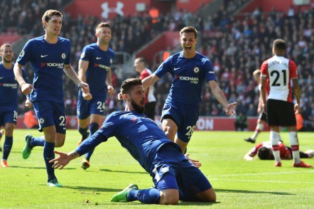 Giroud celebrates scoring his first Premier League goals for Chelsea.