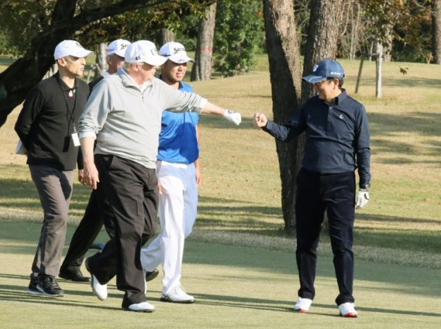 The two golf-mad leaders traded fist-bumps on the course