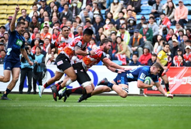 Dalton Papalii of the Blues dives to score a try in their Super Rugby clash with the Sunwolves