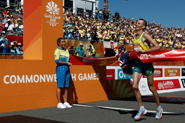 Australia's Michael Shelley crosses the finish line to win the men's marathon during the 2018 Gold Coast Commonwealth Games