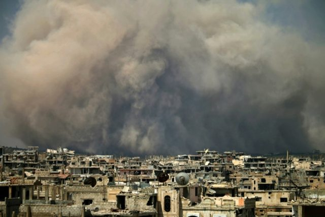 In this file photo taken on August 8, 2017, smoke billows following a reported air strike on a rebel-held area in the southern Syrian city of Daraa