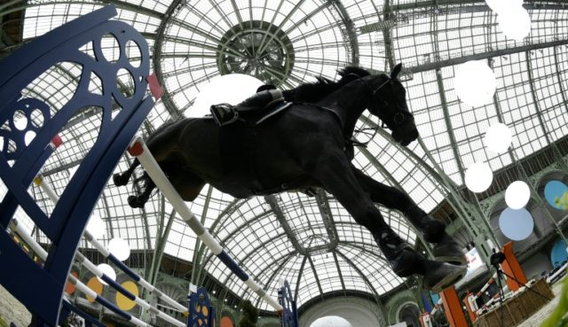 "Colombia's Carlos Lopez riding Admara 2 in the ""Grand Prix Hermes"" at the Grand Palais in Paris in 2016."