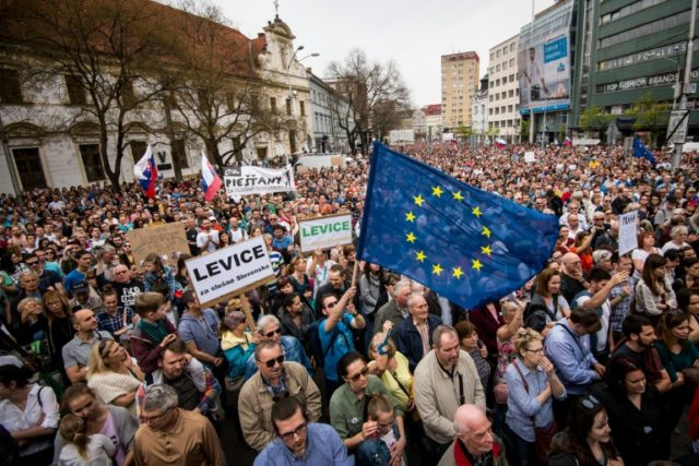 Tens of thousands of Slovaks rallied on Sunday demanding the national police chief resign over concerns that his political connections prevent a fair investigation into the murder of a journalist probing corruption