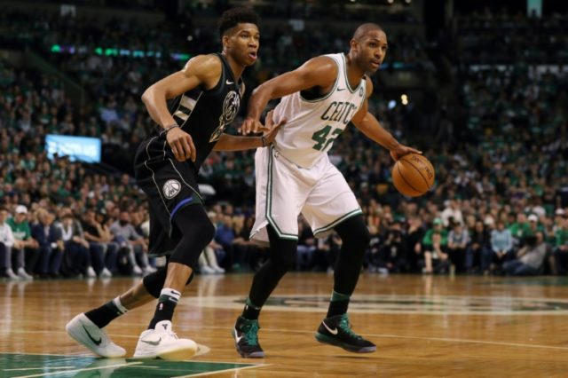 Giannis Antetokounmpo (L) of the Milwaukee Bucks defends Al Horford of the Boston Celtics on April 15, 2018 in Boston, Massachusetts