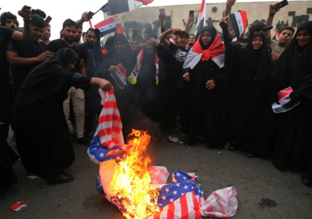 US flags burned as Iraqis protest Syria strikes
