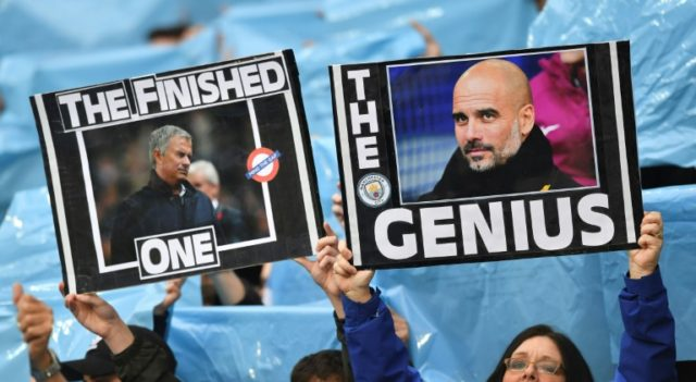 In a nutshell? Manchester City fans hold up placards showing the faces of City manager Pep Guardiola and Manchester United coach Jose Mourinho at last week's game at the Etihad Stadium