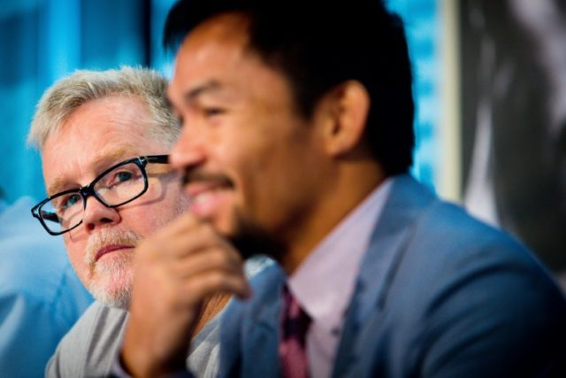 Philippine boxer Manny Pacquiao (R) and former trainer Freddie Roach (L), who said his 15-year association with the former world champion had been terminated ahead of the 39-year-old fighter's upcoming world title fight with Lucas Matthyse