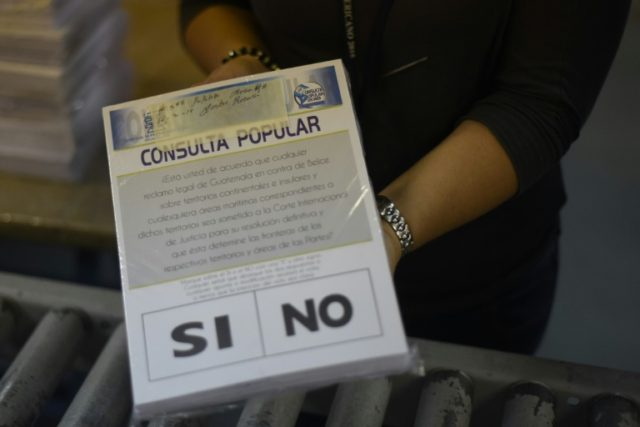 Electoral officials in Guatemala prepare materials for a referendum on whether the country's border dispute with Belize should go to the International Court of Justice