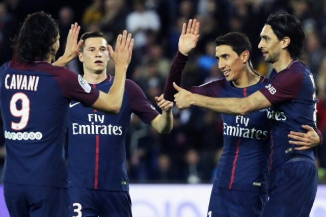 Paris Saint-Germain celebrate one of their goals in their 7-1 win over Monaco on Sunday that sealed the Ligue 1 title