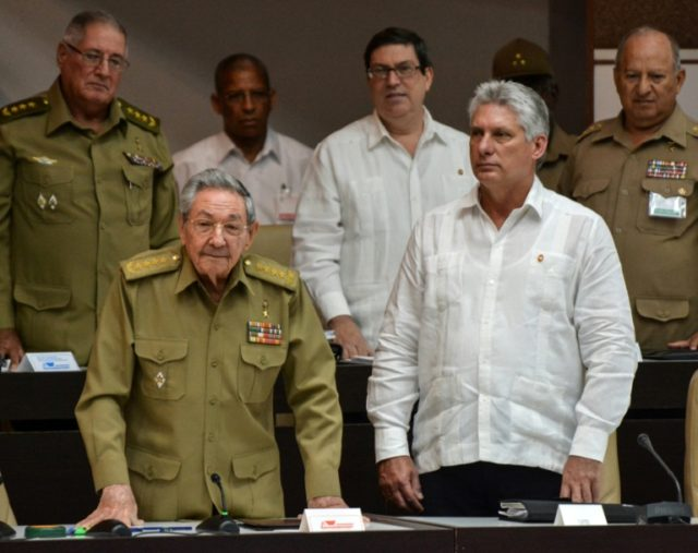 Cuban Vice President Miguel Diaz-Canel, on the right in this 2017 file photo, is expected to be selected Thursday to succeed President Raul Castro, left, ending nearly 60 years of rule by Castro and his older brother Fidel