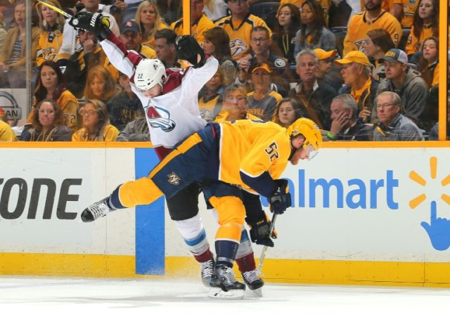 Colin Wilson (L) of the Colorado Avalanche and Matt Irwin of the Nashville Predators collide during Game Two of the Western Conference First Round won 5-4 by the Predators