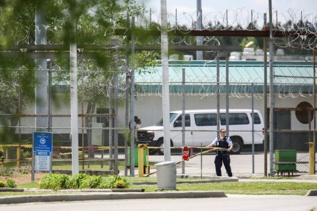 A guard at the entrance to the Lee Correctional Institution in Bishopville, South Carolina, where seven inmates were killed and 17 injured in clashes