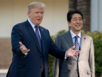 President Donald Trump gestures as he speaks with Japan's Prime Minister Shinzo Abe last year upon his arrival for a luncheon in Japan
