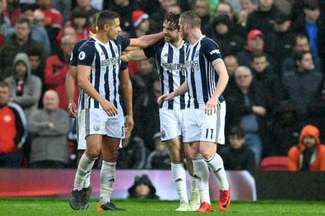 West Bromwich Albion's English striker Jay Rodriguez (2nd R), seen here celebrating with teammates after an English Premier League football match in Manchester on April 15, 2018, slammed Gaetan Bong over an allegation of racism