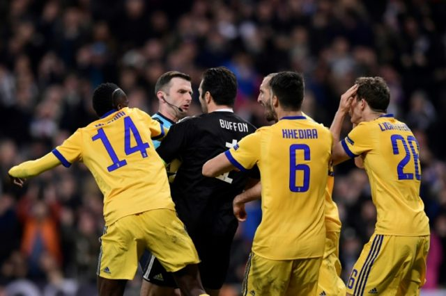 English referee Michael Oliver, seen here during the UEFA Champions League match between Real Madrid and Juventus at the Santiago Bernabeu stadium in Madrid on April 11, 2018, has been offered police support