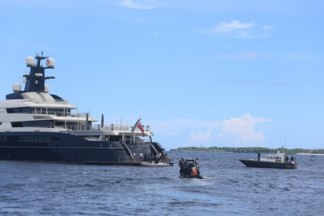 Indonesian officials prepare to board the luxury yacht 'Equanimity' in late February