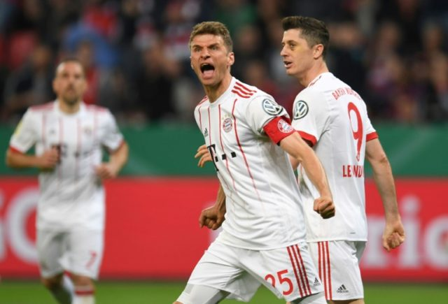 With two goals on the night, Bayern Munich forward Thomas Mueller (L) was the man of the match in a 6-2 German Cup semi-final rout of Bayer Leverkusen