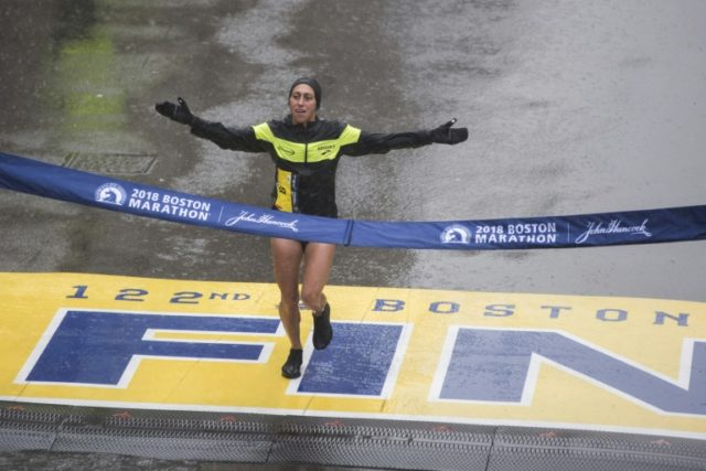 Desiree Linden of the United States crosses the finish line as the winner of the 122nd Boston Marathon