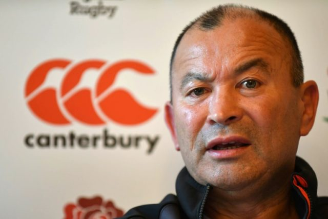 Four men from Scotland have been charged after England rugby coach Eddie Jones was subject to abuse