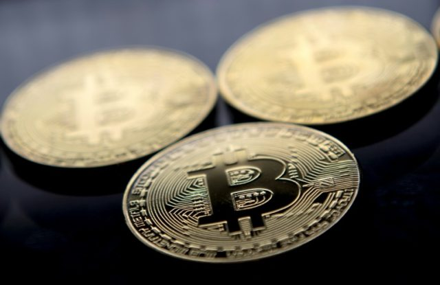 The bitcoin cryptocurrency has risen and fallen in recent months, testing investors' nerves, but the founder of Bitcoin Center in New York says the digital money -- seen here in gold-plated souvenir form -- is not for dilettantes