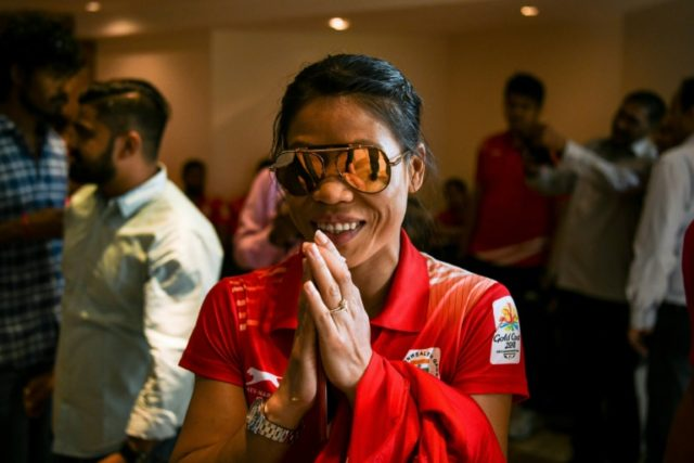 Indian boxer Mary Kom gestures as she arrives at a ceremony for the victorious Indian boxing contingent at the 2018 Commonwealth Games