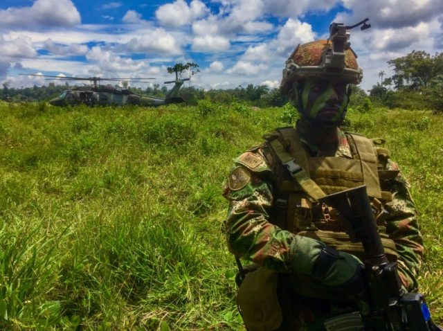 Colombian soldiers are engaged in a massive manhunt for a rebel group that captured and killed a three-member Ecuadoran press team along the two countries' joint border