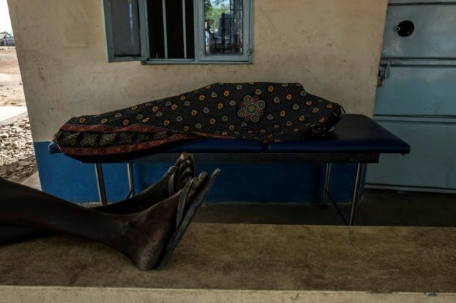 A malaria patient rests at a hospital in South Sudan run by Italian NGO CCM