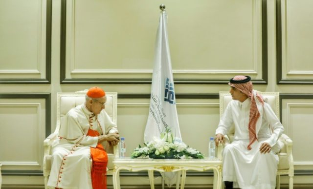 """An image provided by the Global Centre for Combating Extremist Ideology """"Etidal"""" shows Roman Catholic Cardinal Jean-Louis Tauran (L) being received at the centre's headquarters in the Saudi capital Riyadh"""