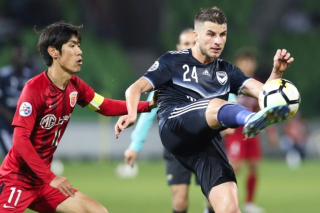 Terry Antonis of Melbourne Victory clears during the AFC Champions League match against Shanghai SIPG