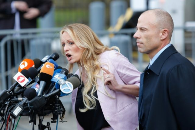 Adult-film actress Stephanie Clifford, also known as Stormy Daniels speaks US Federal Court with her lawyer Michael Avenatti (R) on April 16, 2018, in New York