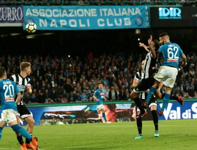 Head's up: Napoli defender Lorenzo Tonelli scores in the 4-2 win